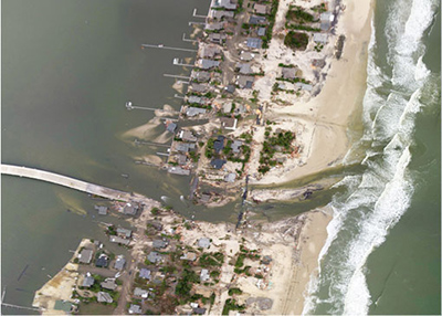 Photo of Breezy Point, New York after Hurricane Sandy storm surges and related fire ravaged the neighborhood, Oct. 2012 (photo credit FEMA)