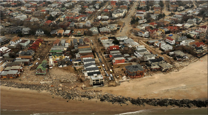 Photo of an aerial view of damage caused by the storm surge of Hurricane Sandy on the coastline of New York, Nov. 2012 (photo credit Jocelyn Augustino, FEMA).